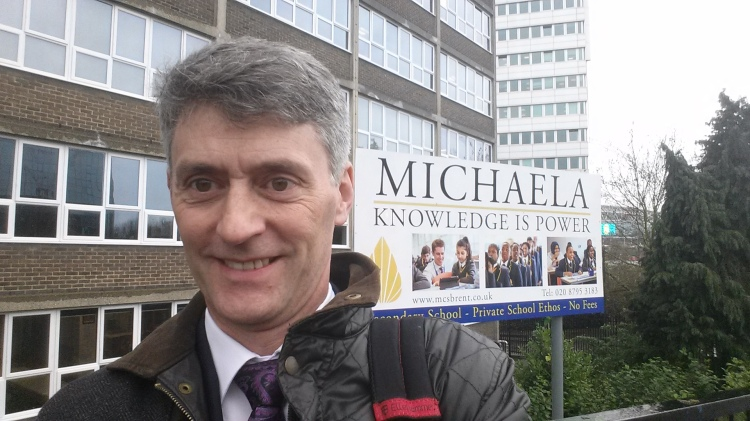 Sign for Michaela with some old bloke stood in front of it